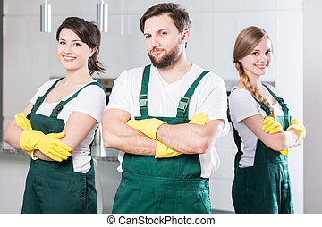 Cleaning team ready to clean the dirtiest room