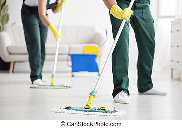 Cleaning team wiping the floor