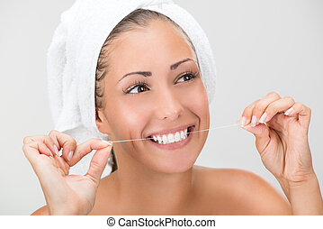 Cleaning Teeth With Dental Floss