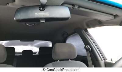 Cleaning the car from the snow. Inside view - Cleaning the...