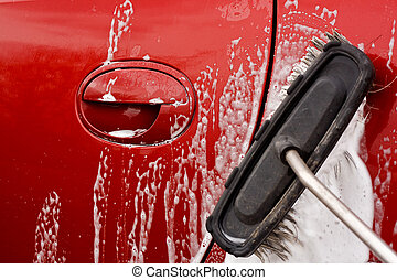 Cleaning the car with a brush - Washing the car with a soapy...