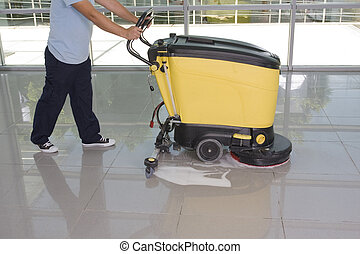 cleaning the floor with equipment
