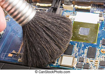Cleaning the motherboard with a brush