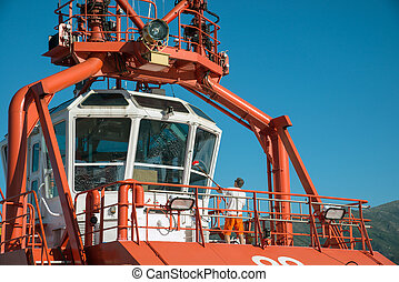 cleaning windows of the cockpit of the tug