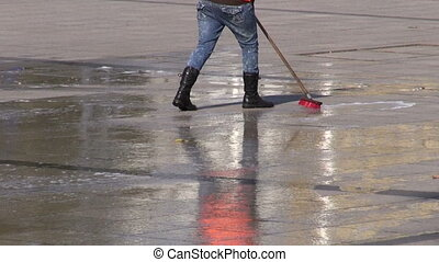 cleaning woman cleaning city square granite pavement