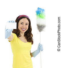 Cleaning woman showing a sign card and holding a duster in her h