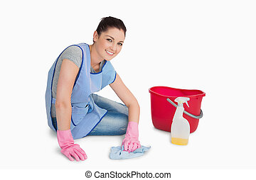 Cleaning woman wiping up the floor on the white background