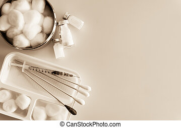 Cleaning wounds with syringes and medicine on sepia tone ...