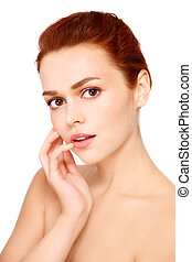 Portrait of young beautiful woman with clear make-up on white background