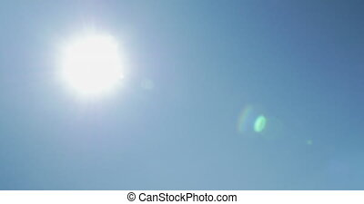 Clear, blue sky and bright sunshine, alternative energy source - solar panels