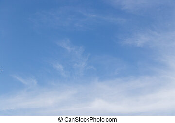 Clear blue sky with white cloud background