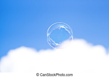 Clear bubble in blue cloudy sky