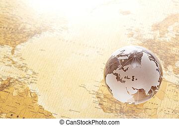 glass globe on world map