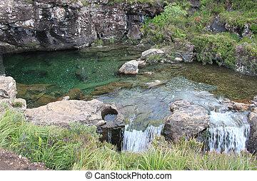 Clear Green rocky pool in the Isle of Skye, Scotland