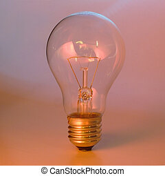 Colorful lighted clear lightbulb