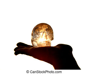 Clear quartz skull on the woman`s open palm