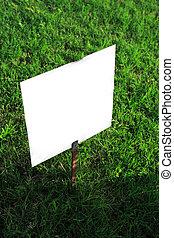 signboard on green grass