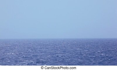 clear sky above blue sea, view from ship - clear sky above...