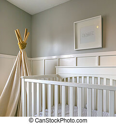 Clear Square Interior of a room for children with white wooden crib and play teepee