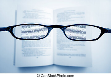 Clear Vision - A pair of glasses above a book, in the lenses...