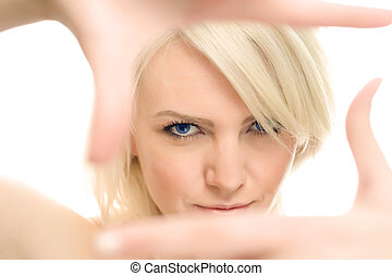 clear vision - young attractive woman framing her hands,...