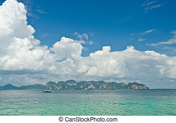 Clear water and blue sky. Beach in Krabi province