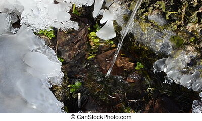clear water flow ice - clear pure water stream flowing into...