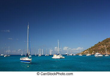 Clear torquoise water, tropical caribbean island, yachts and boats