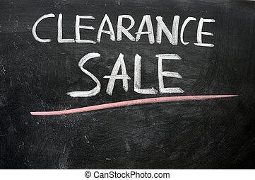 Clearance sale written on a blackboard