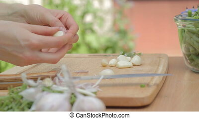 Clearing away dry husk of the garli