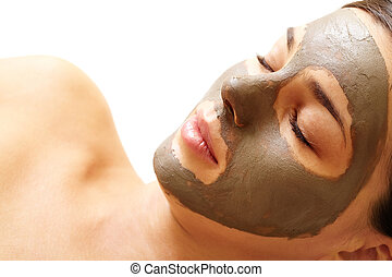 Clearing face - Relaxed girl having pore cleaning procedure...