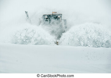 The snowplow clearing the snow after a snowstorm