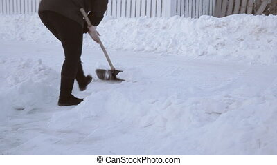 Clearing snow with shovel - Clearing snow with a shovel