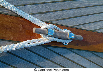 Cleat and rope on a sailboat