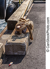 Cleated line and nip bottle on wharf