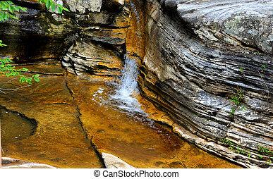 Cleft and Cascade - Ozark Mountain cascade tumbles through a...