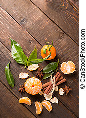 clementine fruits on a rustic wooden table