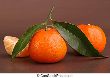 clementine on brown background
