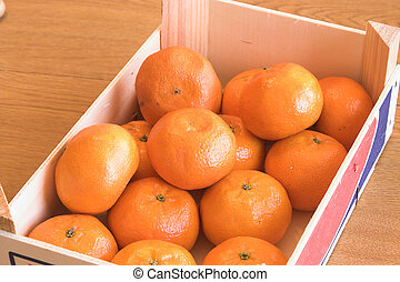 A box of delicious and tiny clementine oranges.