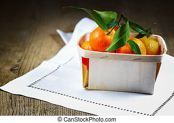 Clementines on table