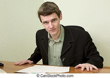 The clerk at office sits at a desktop