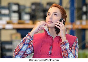 clerk receiving order through the phone