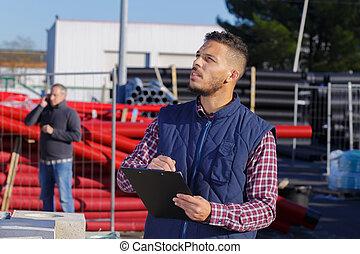 clerk recording the shipment