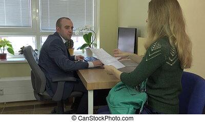 clerk take bribe - Woman give clerk officer man envelope...
