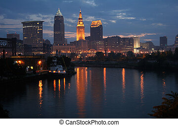 A early morning skyline view of Cleveland, Ohio reflecting on the Cuyahoga River.