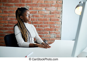 clever African stylish girl with good manners sitting at the table. close up side view shot. copy space