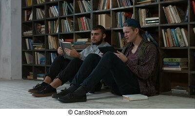 Clever bookworms students in the library studying - Cheerful...