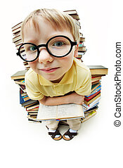 Clever boy - Portrait of diligent pupil sitting on pile of ...