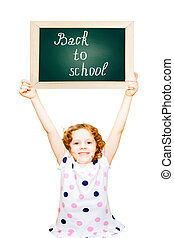 "Clever girl holding a blackboard with the text ""Back to School"" isolated in white."