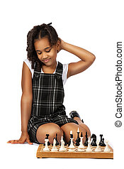 clever girl playing chess thinking